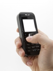 1307593_mobile_phone_in_hand