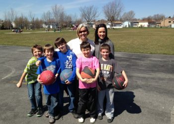 3/4 Earth Day is – L-R, Ryley, Nicholas, Jakob, Connor, Cameron with Mme. Davidson and Mrs McCallum behind, taken in Menard Park