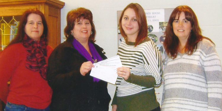 Naomi Lamarche and her Girls' Night Out team presenting a cheque to Baldwin House