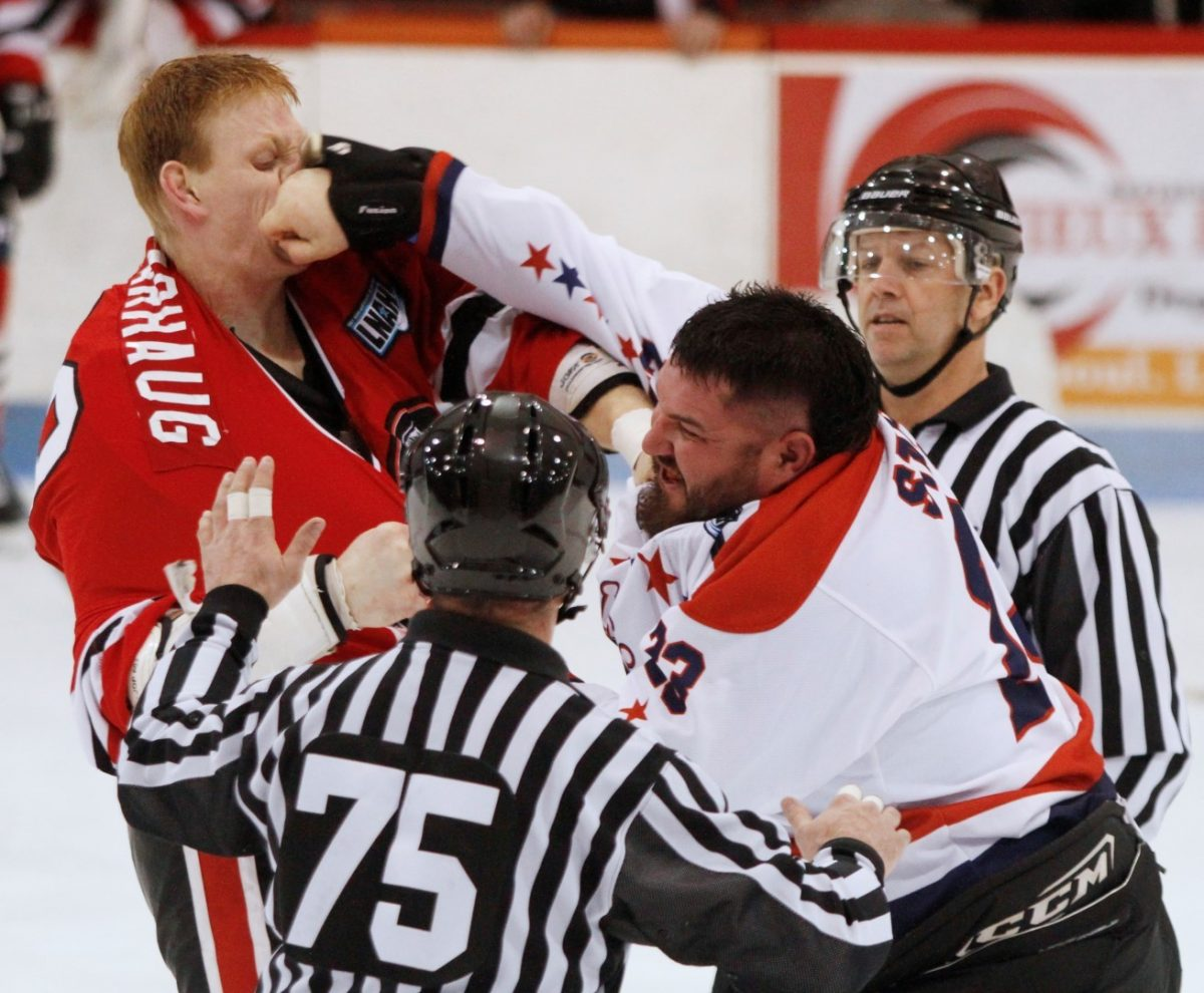 PHOTO by ALLISON PAPINEAU: River Kings enforcer Michael Stacey lands a punch on Mike Varhaug of the Braves in LNAH action on Friday night in Laval.