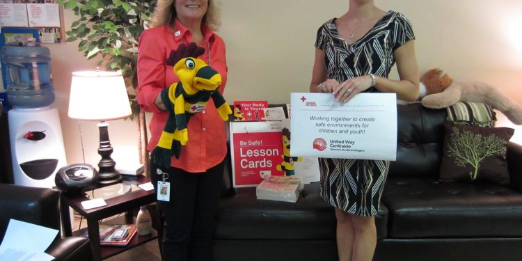 """Shelley Roy, Coordinator with the Canadian Red Cross RespectED: Violence and Abuse Prevention Program presents a Be Safe! kit to Elyse Alguire of KOALA Place. Be Safe! is just one of the RespectED programs available in our community. The Be Safe! kit is part of a personal safety program designed for children ages 5-9 to equip them with the knowledge and skills they need to help protect themselves from sexual abuse. The kit includes everything needed to deliver the program in a positive, child-friendly and non-threatening way. """"Keeping children safe is the most important thing we do as educators and parents. In order to do this, we must provide our kids with the skills they need to protect themselves from sexual abuse, as well as give them an understanding of their right to protect their own body"""", says Shelley Roy. The RespectED program is supported by funding from the United Way of Stormont, Dundas & Glengarry."""