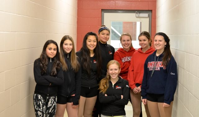 left to right: Nadine Kamm, Makenzie Mitschke, Naomi Wang, Angelina Roundpoint, Kathleen Nicolassen, Emily Lalonde, Tianna Caron.  In front, Madison Needham.  Missing from photo is Emily Hughes.