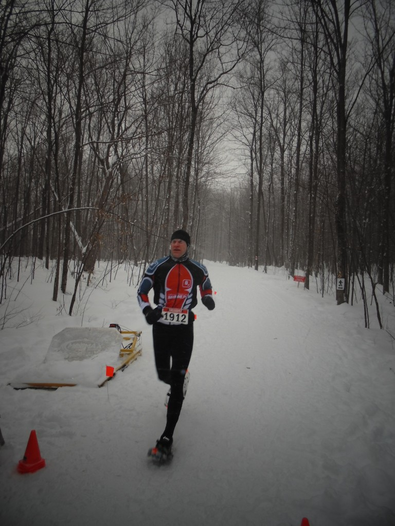 Area resident Rob Lefebvre crossing the finish line in 4th place at the Summerstown Forest Dion Snowshoe Race which was held this past Saturday. Rob is very familiar with the course, living just down the road from Summerstown Forest. Photo credit : FOTST