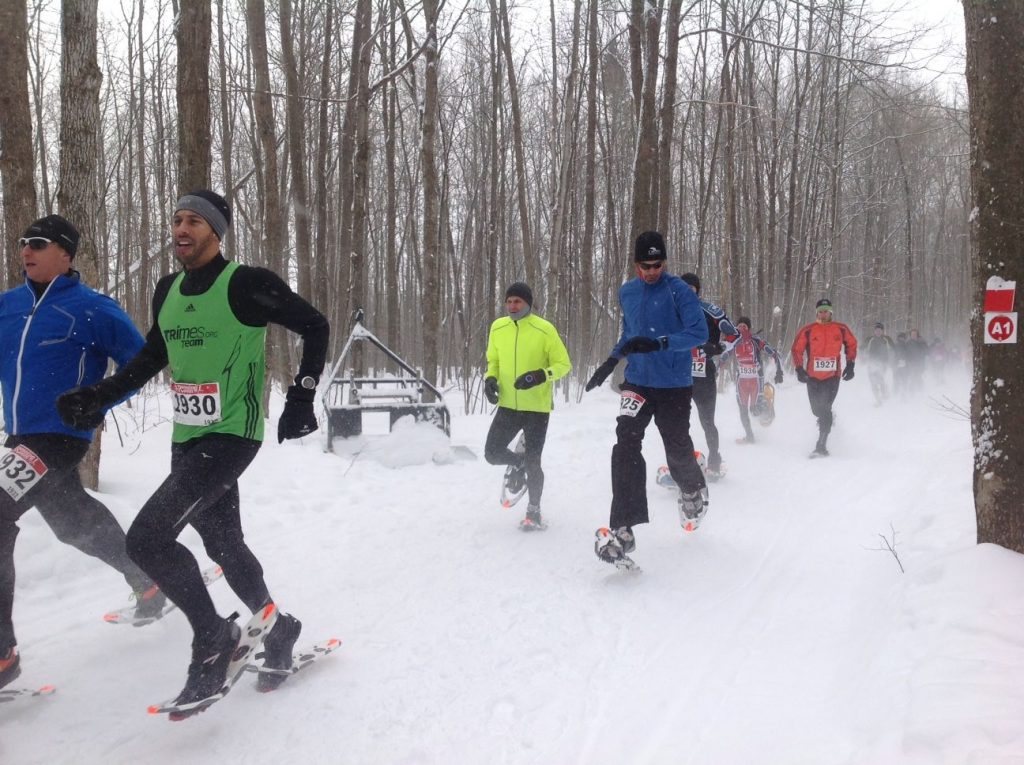 Cornwall resident Sebastian Warner (#1925) checks his time at the start of the Summerstown Forest Dion Snowshoe Race which was held this past Saturday. An avid snowshoer, Warner finished 7th overall in the men's category. Photo credit : FOTST
