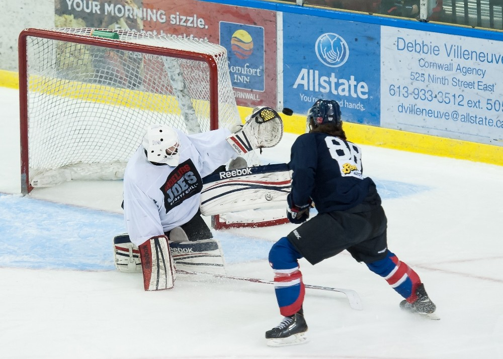 Pete Karvouniaris stops Antony Courcelles during last weekend's Intrasquad game at the Civic Complex.