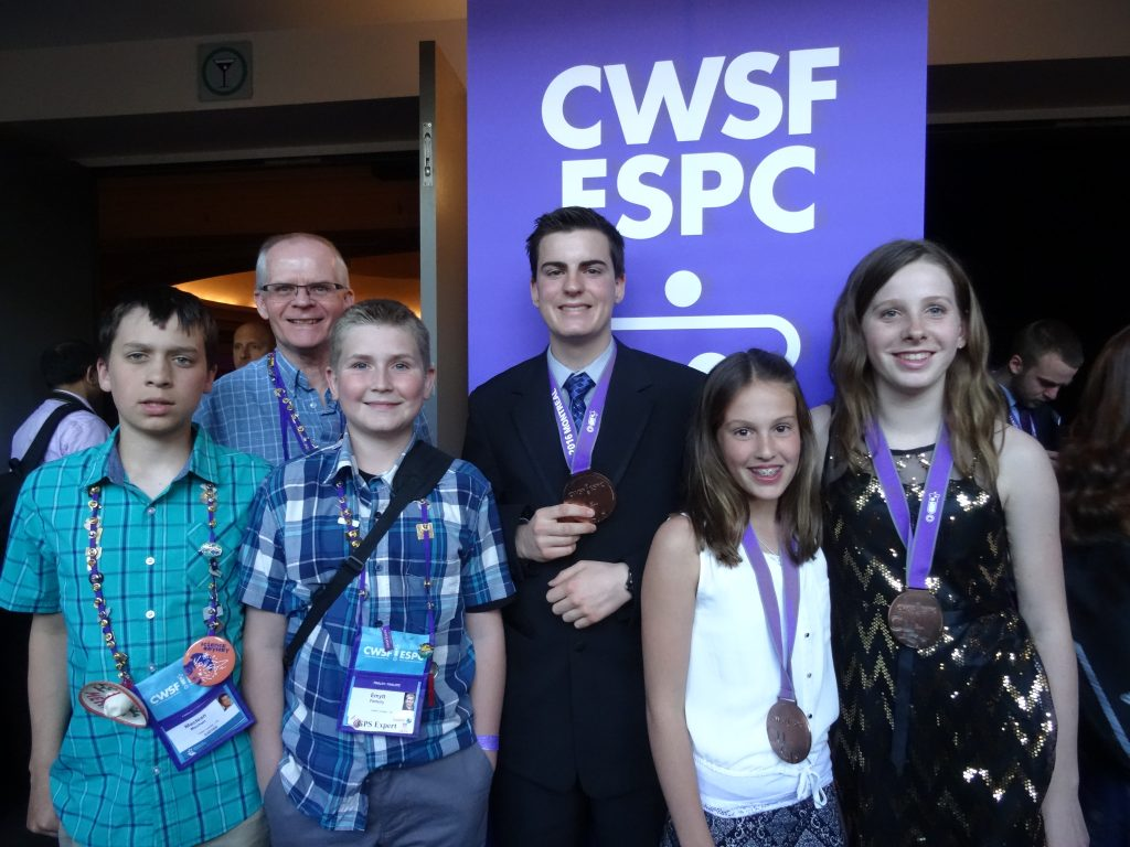2016 Montreal Canada Wide Science Festival finalists and bronze medal winners from the United Counties (front row, left to right: finalists Maclean Machan and Emytt Fetterly from Seaway District High School, bronze medal winners Audrey Millette and Alexa Villeneuve from École Secondaire L'Héritage; back row, left to right: Mike O'Neil, team delegate and chaperone, and bronze medal winner Gabriel Valin from École Secondaire L'Héritage).