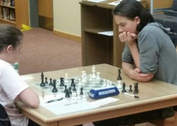 During round 5, Chateaugay's Jacob Hetman works to find an advantage against his opponent, Montreal's Allison Tsypin.