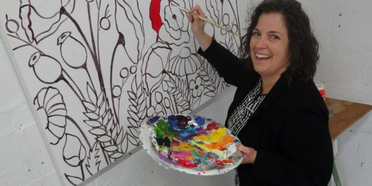 Stephanie Gibson, of McDonad Duncan, adds a splash of colour to an art canvas being unveiled for public painting this Thursday as part of #momstheword.