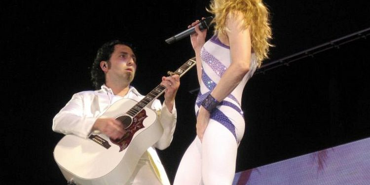 Monte Pittman and Madonna during the Confessions Tour | Photo by AxeStaticProcess WikiCommons