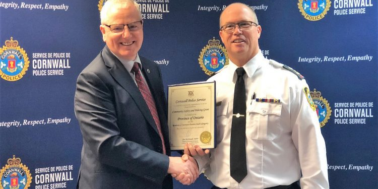 Caption: Left, Jim McDonell, Member of Provincial Parliament for Stormont-Dundas-South Glengarry, presents a certificate of congratulations to Cornwall Police Service Chief of Police Danny Aikman, on Friday, December 13, 2019 in Cornwall, Ont.