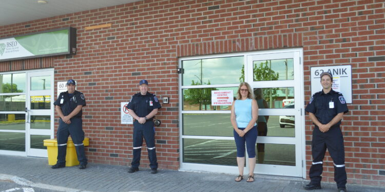 Primary Care Paramedic Leigh Keeler, Primary Care Paramedic Leigh Wheeler, Eastern Ontario Health Unit Program Manager Linda Cleroux, and Primary Care Paramedic Brandon Cass.