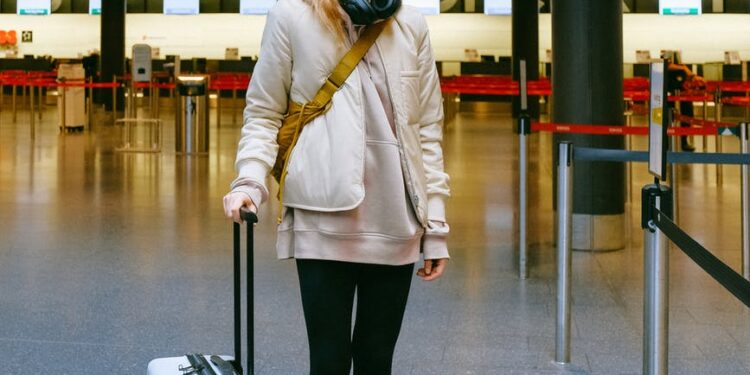 woman wearing face mask at airport