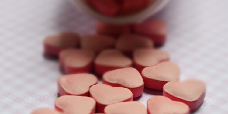 selective focus photo of pink tablets