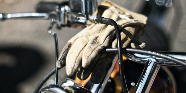 photo of a glove on motorcycle handlebar