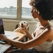 african american female freelancer with laptop and dog