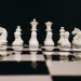 white chess piece on top of chess board