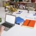 photo of orange book beside laptop