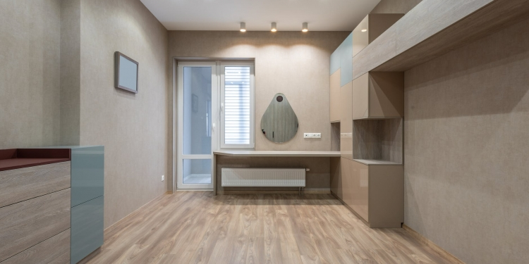 spacious room with cupboards and door