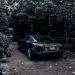 photo of audi parked near trees