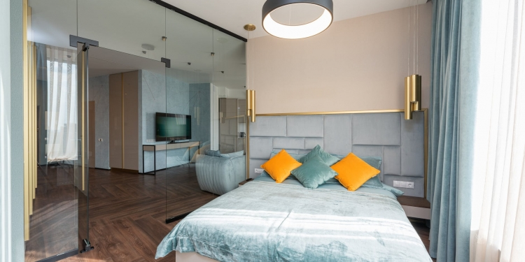 interior of spacious bedroom with comfy bed and modern design