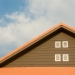 orange and gray painted roof under cloudy