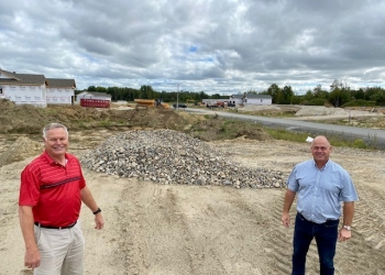 Photo supplied by North Dundas Photo (growth): Pictured, Director of Planning, Building and Enforcement Calvin Pol stands with Mayor Tony Fraser in the Wylie Creek Estates Subdivision in Hallville.