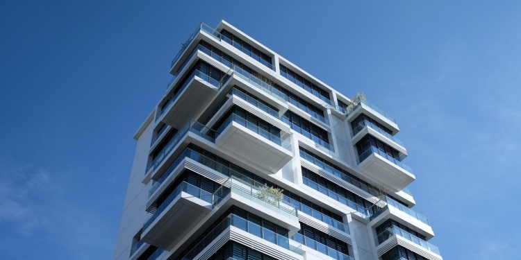 white concrete building under sunny blue sky