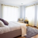 white bed comforter during daytime